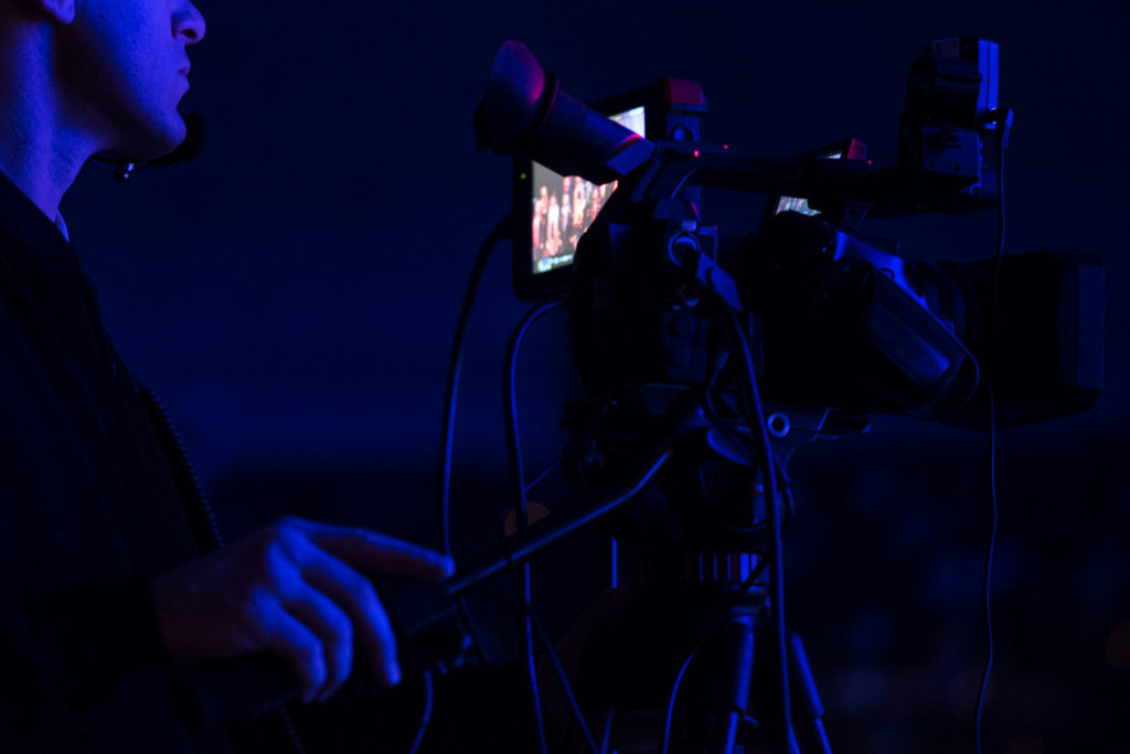 171217-N-DD694-1127 WASHINGTON (Dec. 17, 2017) Musician 1st Class James Anderson operates a video camera during the United States Navy Band's annual Holiday Concert. The Holiday Concert is one of the Navy Band's largest productions of the year. (U.S. Navy photo by Musician 1st Class Jonathan Barnes/Released)